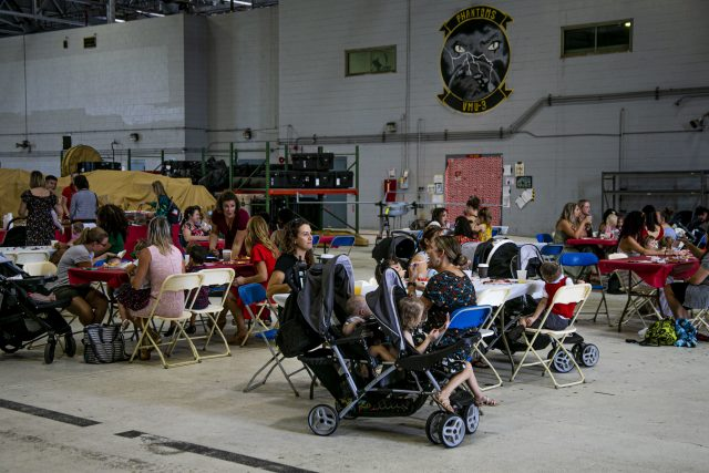 Families of U.S. Marines with Marine Unmanned Aerial Squadron 3, Marine Aircraft Group 24, take part in the unit's deployed spouses brunch on Marine Corps Base Hawaii, Dec. 18, 2019. The event was supported by the United Service Organization to provide service to the families of Marines on deployment during the holidays. (U.S. Marine Corps photo by Lance Cpl. Jacob Wilson)
