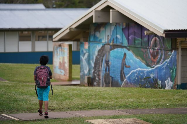 Lanai High and Elementary School student walks to his class on the elementary school side of campus.