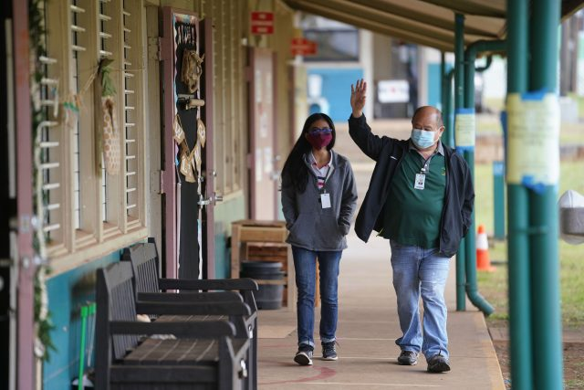 Lanai High and Elementary School teacher Daisy Lyn Dela Rosa walks with Principal Elton Kinoshita.