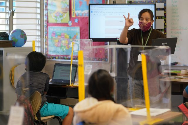 Lanai High and Elementary School. Elementary school teacher Ninez Abonal gestures during a lesson in class.