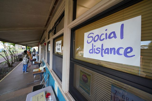 Lanai High and Elementary School sign warning students to keep in mind 'social distance' during the COVID-19 pandemic.