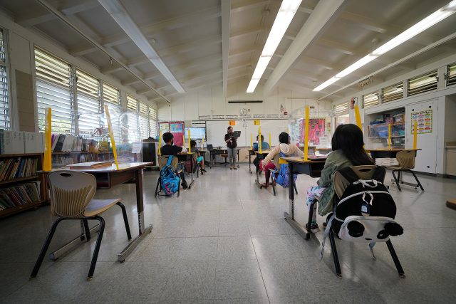 Lanai High and Elementary School. Elementary school teacher Ninez Abonal teaches as students are socially distanced and sit behind plastic barriers.