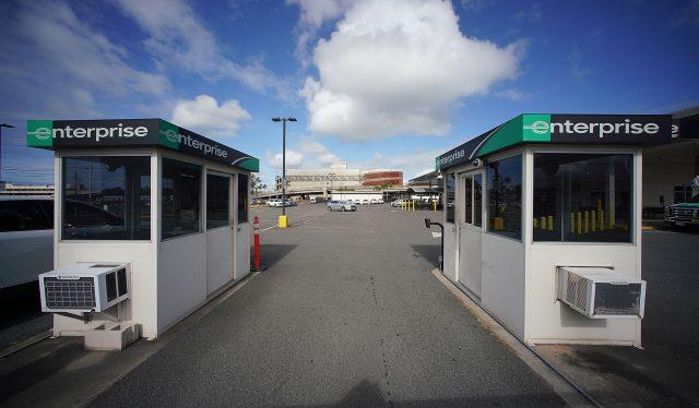 Enterprise Rent-A-Car's rental lot is empty with no cars at Daniel K Inouye International Airport.