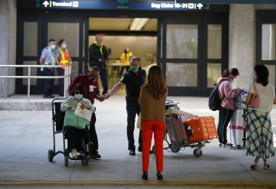 VIsitors arrive from an inbound arrival from Haneda, Japan at Daniel K. Inouye International Airport.