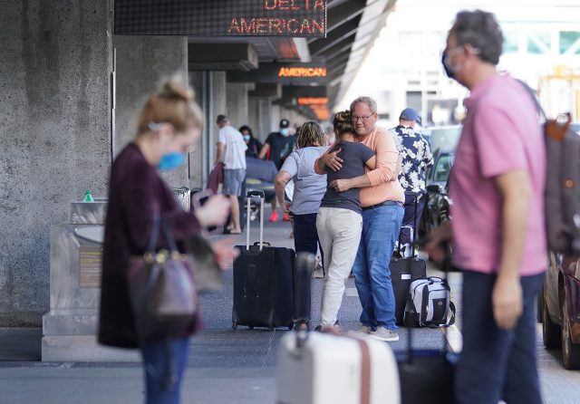 Passengers say goodbye to loved ones on the departure level at the Daniel K. Inouye International Airport during the COVID-19 pandemic. April 1, 2021