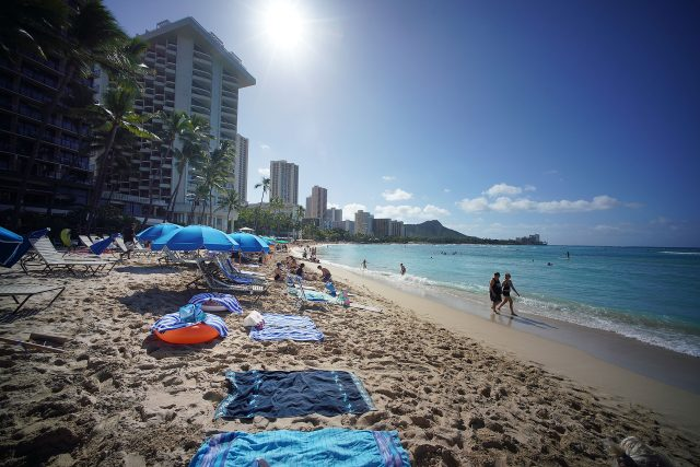 Waikiki Beach with more visitors arriving every day on Oahu during the COVID-19 pandemic.