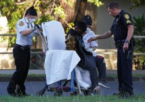 EMS and HPD assist with suspect along Kalakaua Avenue after 16-year-old driver was shot and killed by police.