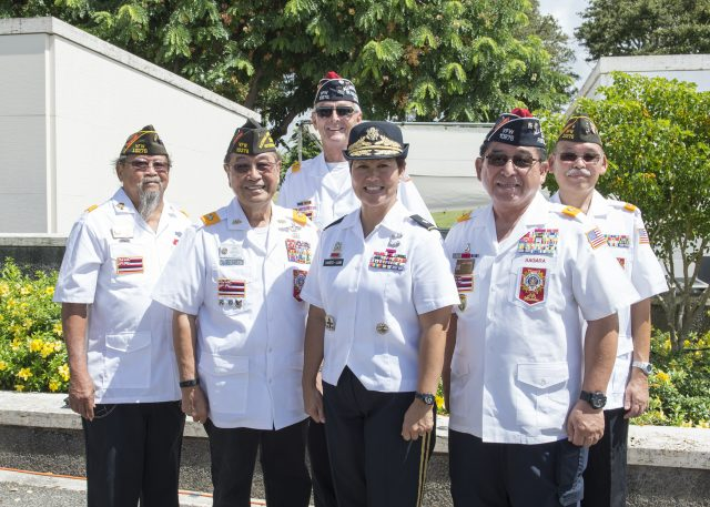 U.S. Navy Brig. Gen. Suzanne P. Vares-Lum, Mobilization Assistant, Strategic Planning and Policy of U.S. Pacific Command, pose for a photo with members of Veterans of Foreign Wars at the 11th Annual Joint Memorial Service at the National Memorial Cemetery of the Pacific in Honolulu, Hawaii, Sept. 25, 2016. The service is to honor Japanese American soldiers who served and sacrificed their lives during WWII. (U.S. Navy photo by Mass Communication Specialist 1st Class Jay M. Chu)