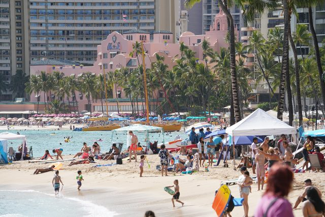 Scores of visitors along Waikiki Beach during COVID-19 pandemic and the return of tourism and visitors. April 11, 2021