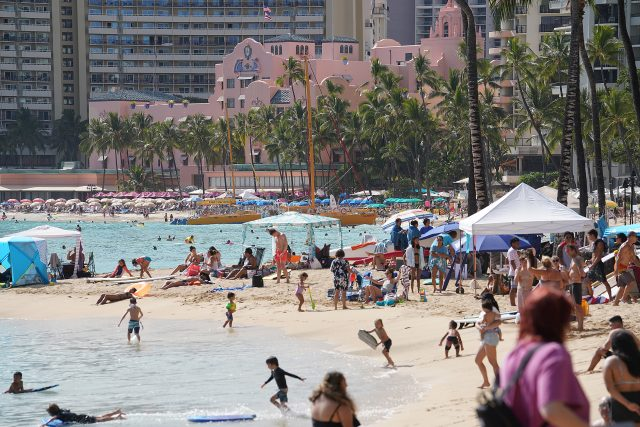 Sunday at Waikiki Beach with a backgrop of the Royal Hawaiian Hotel and beachgoers and public enjoying the beach during the COVID-19 pandemic. April 11, 2021