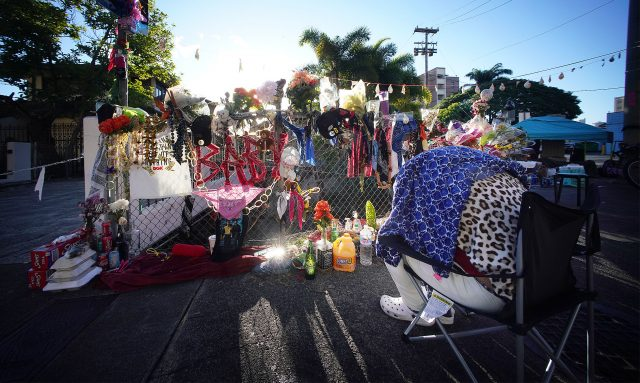 People sleep along Kalakaua Avenue and Philip Street where a memorial was erected to honor Iremamber Sykap after being shot by the Honolulu Police Department. Photo taken on April 14, 2021