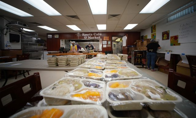 Staff at Kokua Kalihi Valley prepare food to be shared with seniors at their senior center located nearby on Gulick Street.