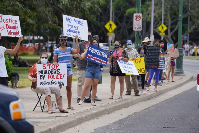 'Stop Murders by Police!' demonstration at the intersection of Kapahulu Avenue and Kalakaua Avenue.
