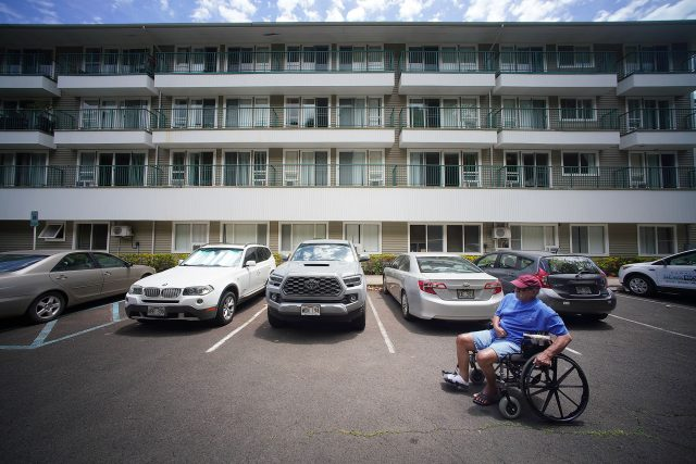 Dignity Senior Living at Oceanside Hawaii resident Al Richardson heads back to the entrance with his wheelchair.