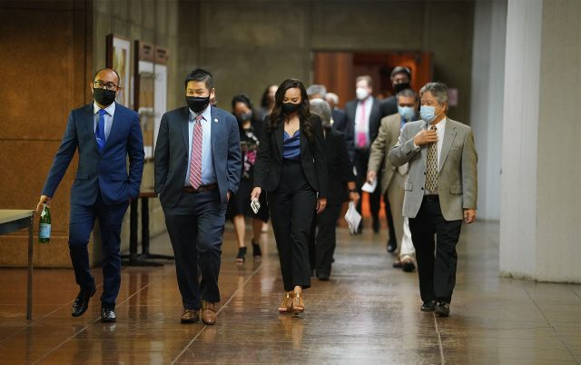House members walk from the chambers to the auditorium to Caucus during COVID-19 pandemic.