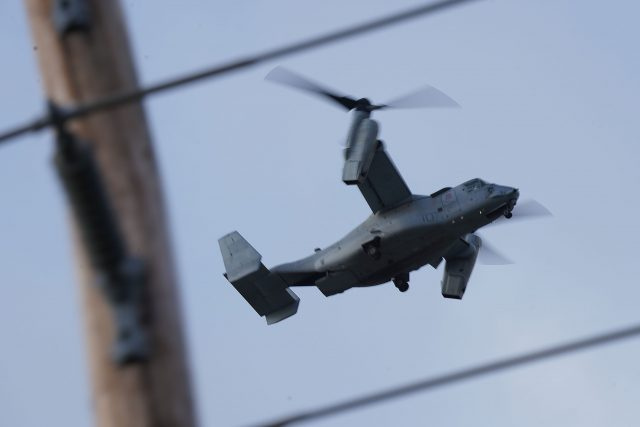 Low flying Bell Boeing V22 Osprey military aircraft travels over Beretania Street.