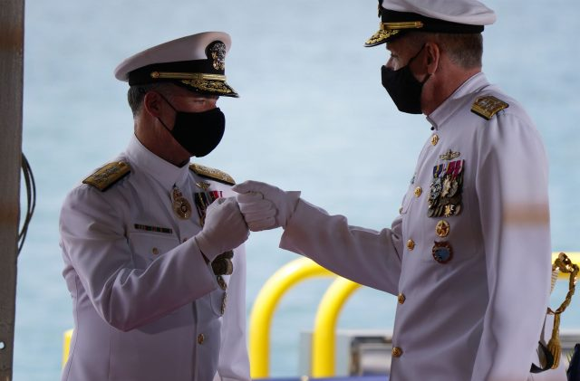 US Indo-Pacific Command change of command ceremony as right, Admiral Philip Davidson gives knuckles to the incoming commander Admiral John Aquilino.