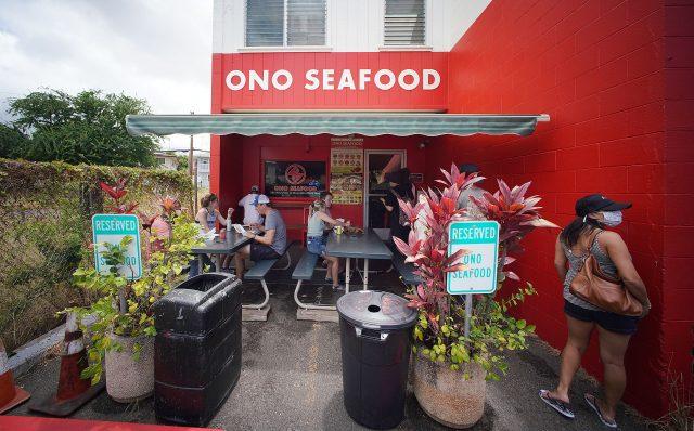 Scores of people line up outside Ono Seafood Honolulu located along Kapahulu Avenue.