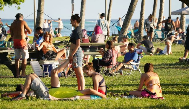 Crowds gather at San Souci State Recreational Park near Waikiki Beach on a sunday during COVID-19 pandemic. April 9, 2021
