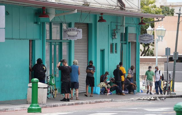 Patrons enjoy lunch at the River of Life Mission located along Pauahi Street in Chinatown.