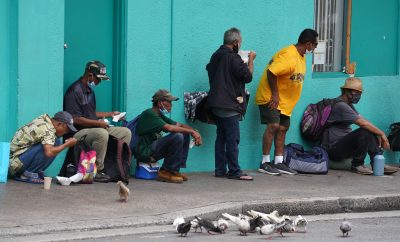 Patrons eat lunch outside the River of Life Mission located on Pauahi Street in Chinatown.