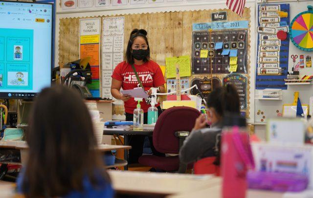 Honowai Elementary School Kindergarten teacher May Anne Kim teaches in her classroom.