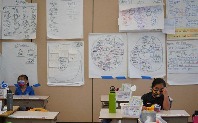 Honowai Elementary School Kindergarten teacher May Anne Kim's classroom as she instructs students.