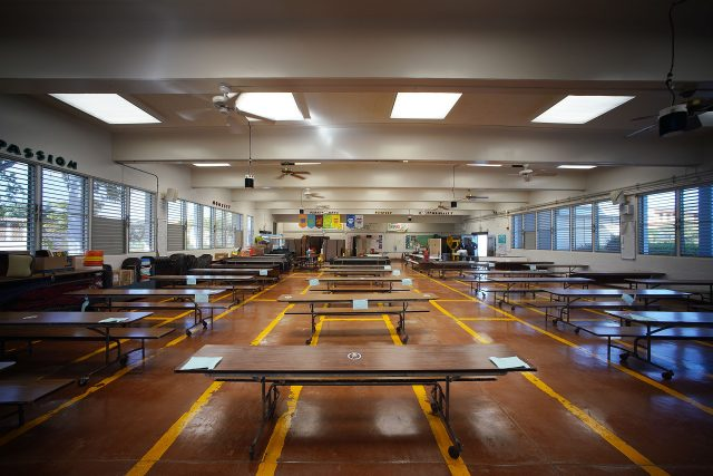 Honowai Elementary School cafeteria with special UV-C lights hanging from ceiling.