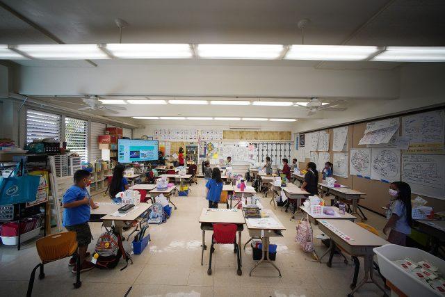 Honowai Elementary School Kindergarten Teacher May Anne Kim in her classroom as students recite the 'Pledge of Allegiance'.