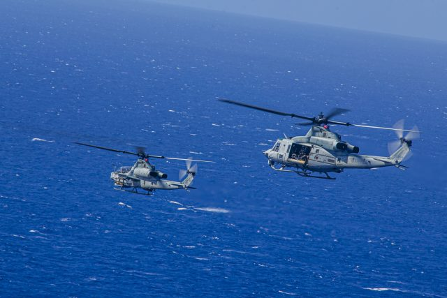 U.S. Marines with Marine Light Helicopter Attack Squadron 367 operate an AH-1Z Viper and UH-1Y Venom during a joint maritime strike exercise with U.S. Navy Helicopter Maritime Strike Squadron 37 over Pacific Missile Range Facility, Hawaii, June 9, 2020. HMLA-367 and HSM-37 conducted the training to exercise sea control and sea denial operations. (U.S. Marine Corps photo by Lance Cpl. Jacob Wilson)