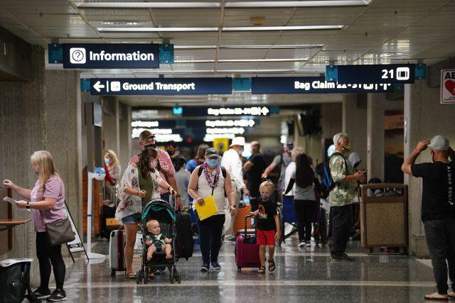 Passengers arrive to luggage pick up area at Daniel K. Inouye International Airport.