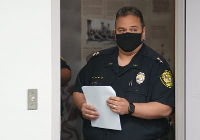 HPD Acting Police Chief Rade Vanic walks into room before press conference.