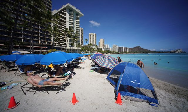 Beachgoers enjoy Waikiki Beach as more mainland US visitors arrive to Oahu and the outer islands during COVID19 pandemic.
