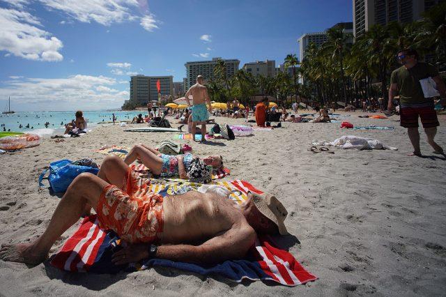 Beachgoers enjoy the sun at Waikiki Beach during the COVID-19 pandemic.