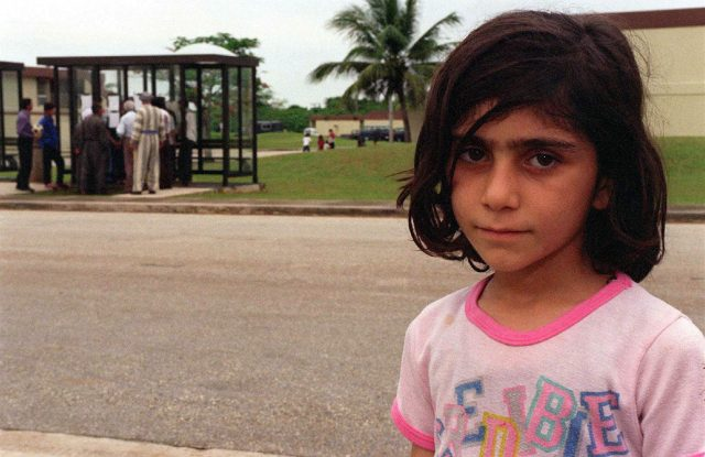 A Kurdish girl stands outside her temporary residence at Andersen Air Force Base, Guam, while being housed at the base as part of Operation PACIFIC HAVEN. The operation, a joint humanitarian effort conducted by the US military, entails the evacuation of over 2,100 Kurds from northern Iraq to avoid retaliation from Iraq for working with the US government and international humanitarian agencies. The Kurds will be housed at Andersen AFB, while they go through the immigration process for residence in the United States.