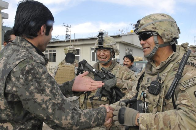 Hawaii Army National Guard Command Sgt. Maj. Craig Ynigues (right), noncommissioned officer in charge for Security Forces Assistance Team 21 greets 2nd Lt. Asif Tohki, commander of the Afghan Uniformed Police Qalat Reserve Kandak in Qalat, Afghanistan, Jan. 14. 2013. Ynigues, 52, from Kailua-Kona, Hawaii, is part of the 29th Infantry Brigade Combat Team advising the QRK, the largest Afghan Uniformed Police element in Zabul province, in preparation for the 2014 handover of security responsibilities. (U.S. Army photo by Sgt. Lori Bilyou)