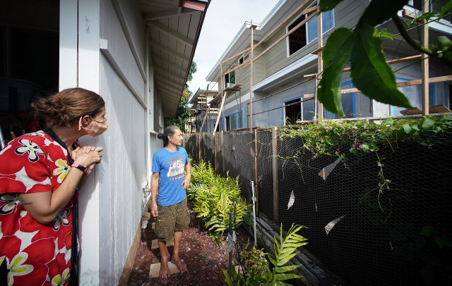 Left, Molly Jenkins and Nakana Wong looks towards large two story homes, part of Christy Zeng Lei's newest development in Kaimuki.