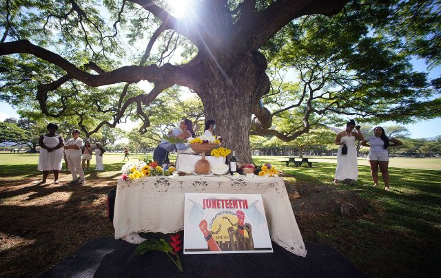 Juneteenth celebration held at Kapiolani Park with altar in center of the photograph.