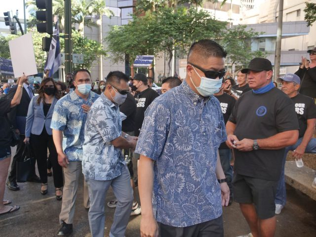 3 HPD officers arrive for their first court appearance in Honolulu on Friday, June 25, 2021. Photo by CIvil Beat Ronen Zilberman.