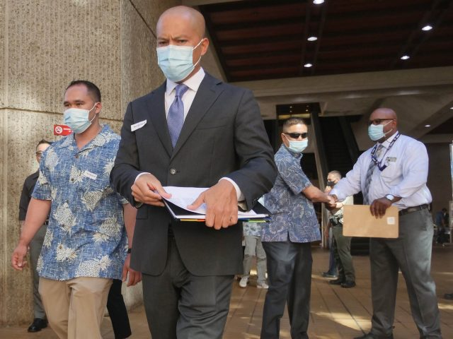 Three HPD officers charged in the shooting death of Iremamber Sykap leaving the Alakea Street courthouse in Honolulu on Friday, June 25, 2021. CIvil Beat photo