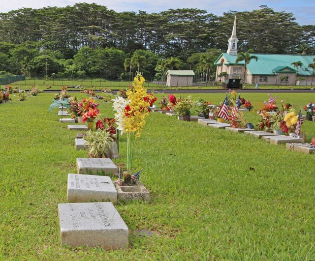 A row of misaligned gravesite markers at Hilo's Veterans Cemetery (Two). Photo: Tim Wright