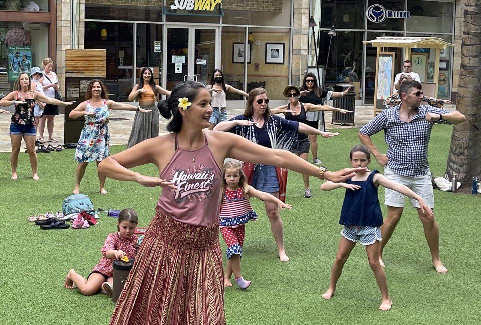Kaleo Kia teaches a hula class free to the public in Waikiki Sunday July 11, 2021. The class is held every Sunday at Waikiki's Beach Walk from 9 - 10am. (Ronen Zilberman photo Civil Beat)