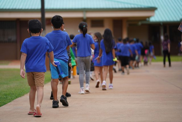 Holomua Elementary School students lineup and head back to their classrooms after recess.