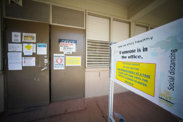 Front entrance to the office administration building at Ilima Intermediate School with COVID-19 warning precautions. July 27, 2021