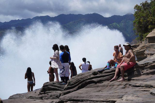 Large waves crash along China Walls located in Maunalua Bay.