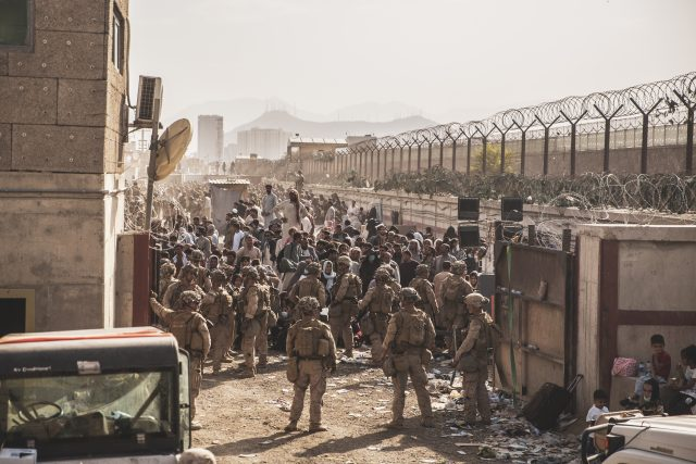 U.S. Marines with Special Purpose Marine Air-Ground Task Force - Crisis Response - Central Command, provide assistance at an Evacuation Control Checkpoint (ECC) during an evacuation at Hamid Karzai International Airport, Kabul, Afghanistan, Aug. 21. U.S. service members are assisting the Department of State with a non-combatant evacuation operation (NEO) in Afghanistan. (U.S. Marine Corps photo by Staff Sgt. Victor Mancilla)