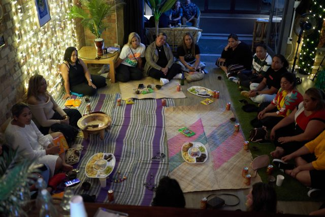 Women sit around the kava bowl, At Four Shells Kava Lounge in Auckland, New Zealand