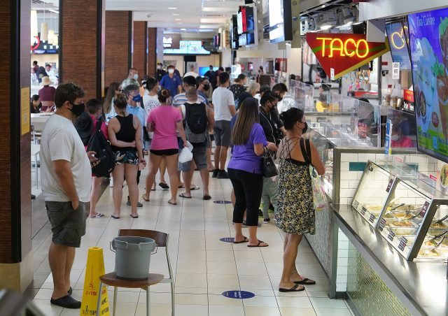 Looked like business as usual as crowds flocked to Ala Moana Shopping Center food court during a recent surge in Covid-19 cases. Statewide positive cases topped over 1000 today. August 27. 2021