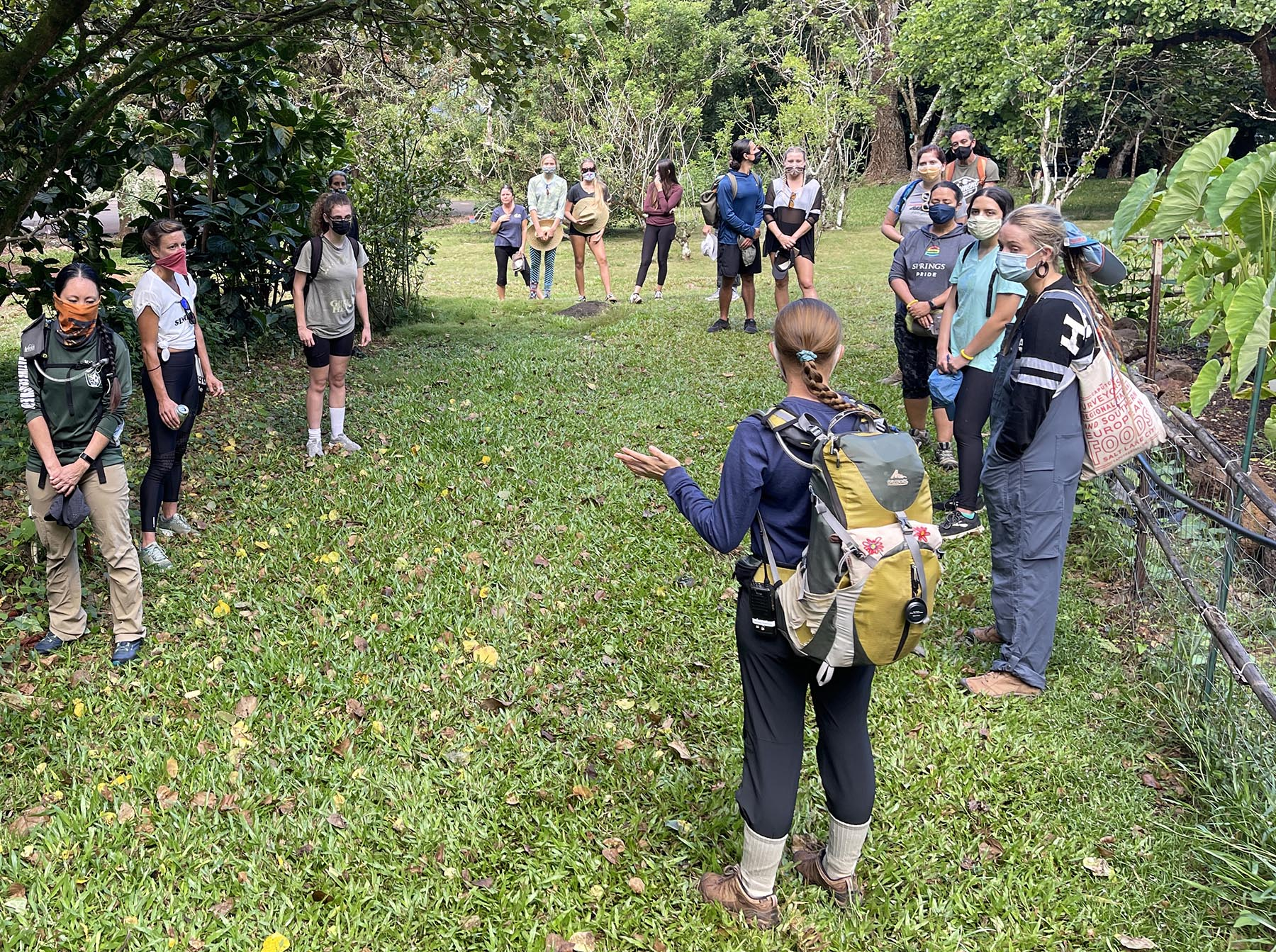 """<p>Melani Spielman, volunteer coordinator for the nonprofit Hi'ipaka, leads volunteers in a Hawaiian oli, before they begin their hike up to Kalahe'e Ridge. The purpose of the oli was equivalent to """"knocking on the door"""" to ask permission of ancestors and spirits of the valley before entering the space.</p>"""