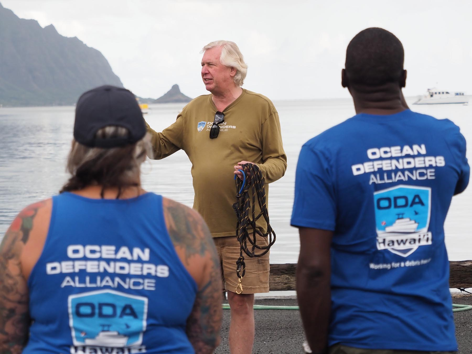 <p>Kurt Lieber, president and founder of the nonprofit Ocean Defenders Alliance, explains procedures for removing tires and debris from the sea floor. Volunteers split up into two crews working below and above the water. Lieber says the abandoned tires contain over 100 chemicals that leach into the water over time.</p>